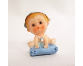 ceramic baby on pillow